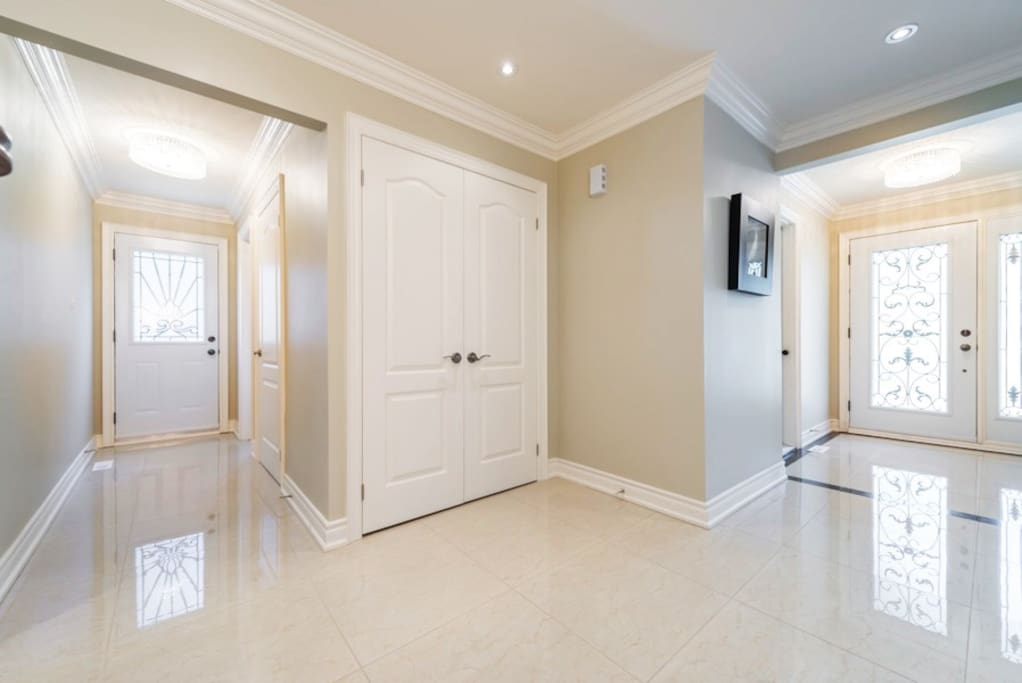 Front entrance. Marble floors and natural light