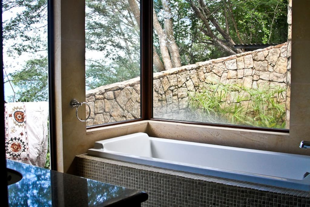 Take a bath and enjoy the view of the ocean and the mountains from the bathrooms