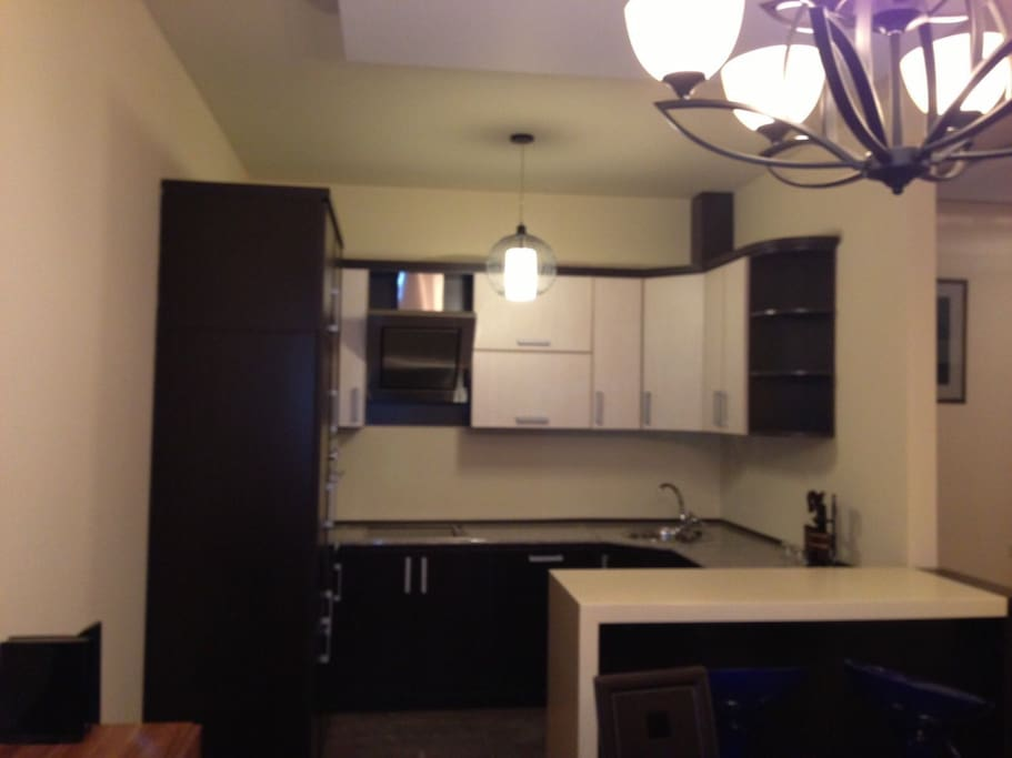 Kitchen fully stocked. Includes Dishwasher