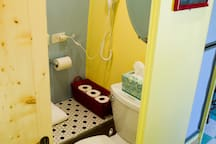 The bathroom has been hard plumbed with a real toilet.  There's an interior shower and hairdryer, too.