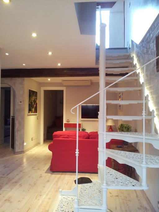 The iron ladder leading to the kitchen and terrace.