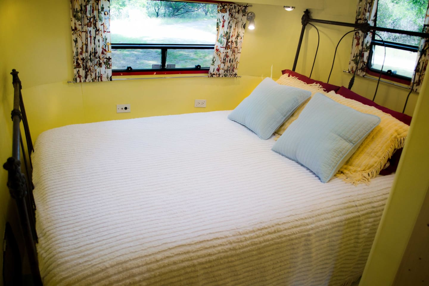 Queen size bed on an antique iron bed frame