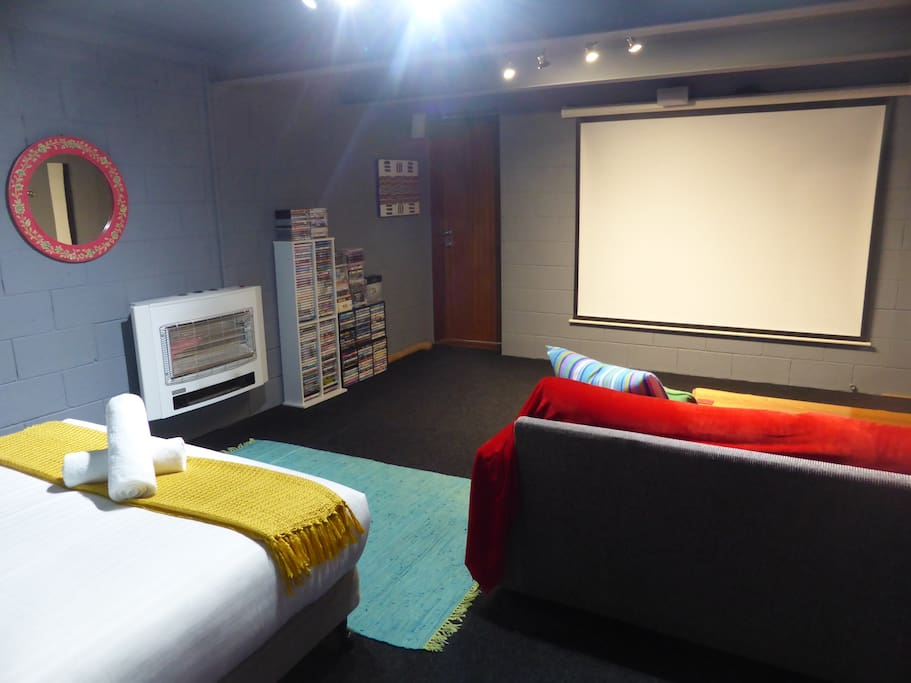 """Huge 100"""" projector screen. Watch movies or a tv series from your bed!"""