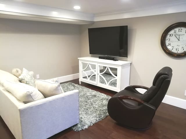 Great room attached to kitchen/dining.  It has a large smart tv with Netflix, Hulu & Vudu. Couch pulls out to a full size bed.