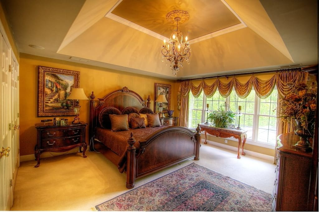 Lovely master bedroom, king bed, large windows overlooking pool.