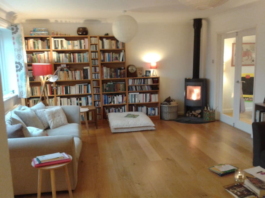Living room (6x4m), wooden floor, woodburning stove, TV, 1 sofa, 1 sofabed