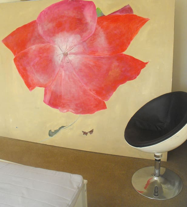 vintage swivel chair and painting