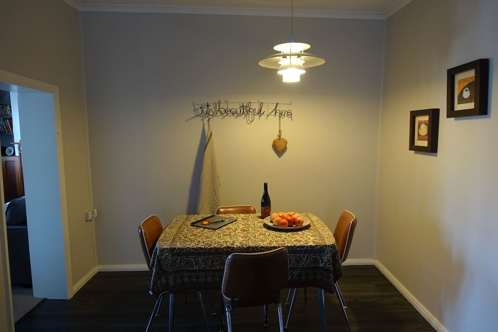 Cosy dining area. Welcoming bottle of wine.