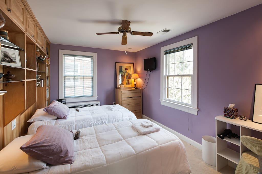 Guest bedroom.  Twin beds are adjustable. So quiet.  Looks on the garden.  Bathrobes on the door hangers.