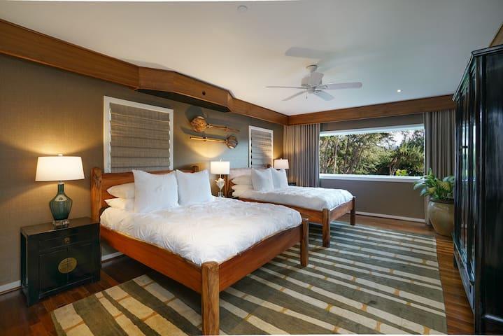 2 Queen beds with luxury bedding, calming views, dresser, TV and workspace.