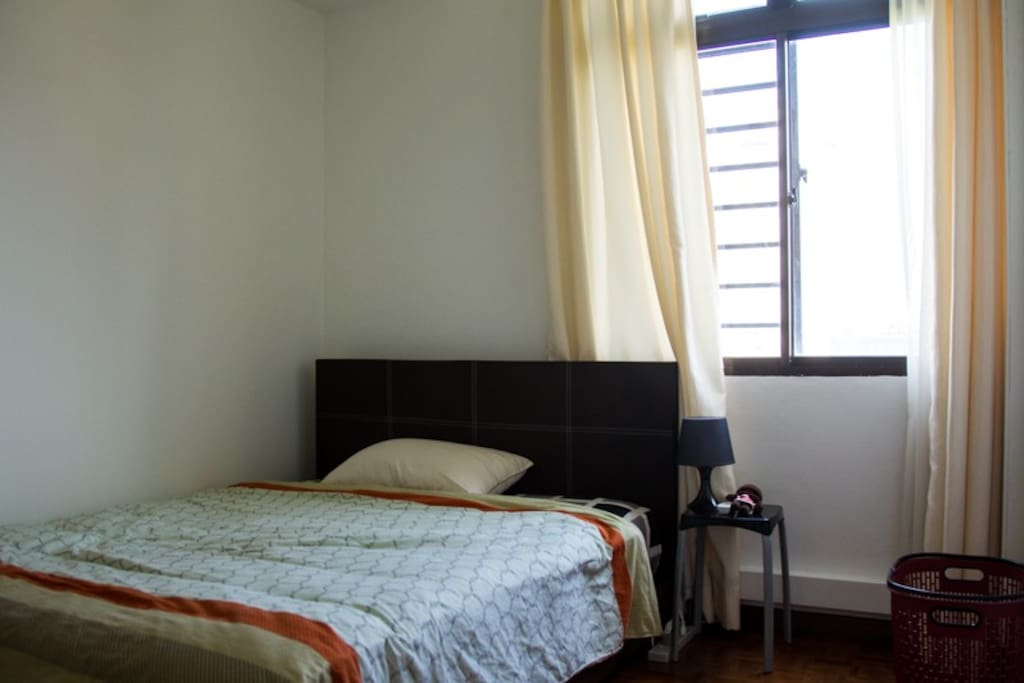 Room comes with a new queen bed, attached private toilet and a huge wardrobe