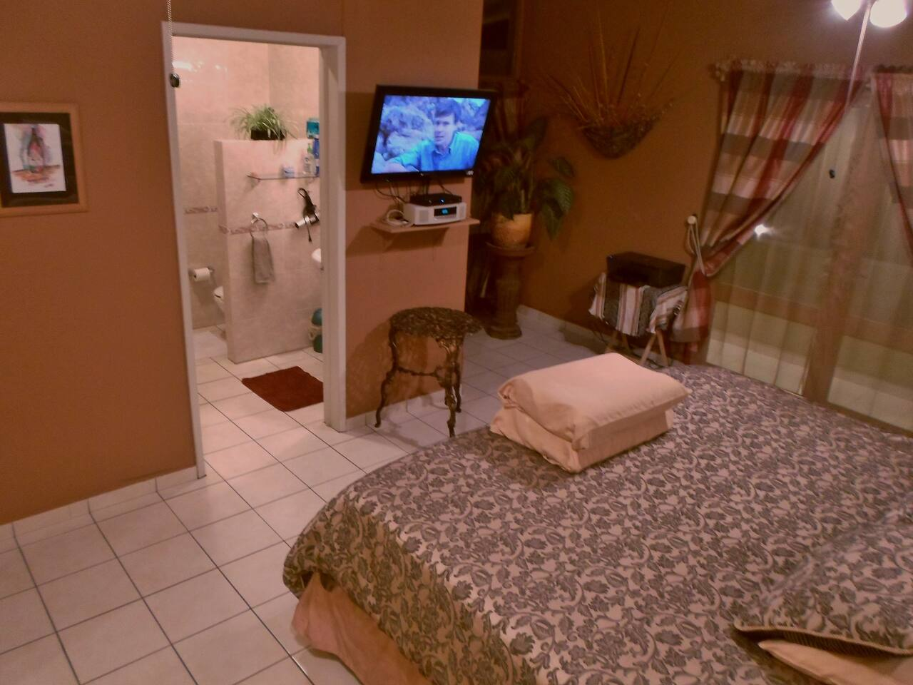 A private bathroom add to the privacy of this large room that is appreciated for longer stays.