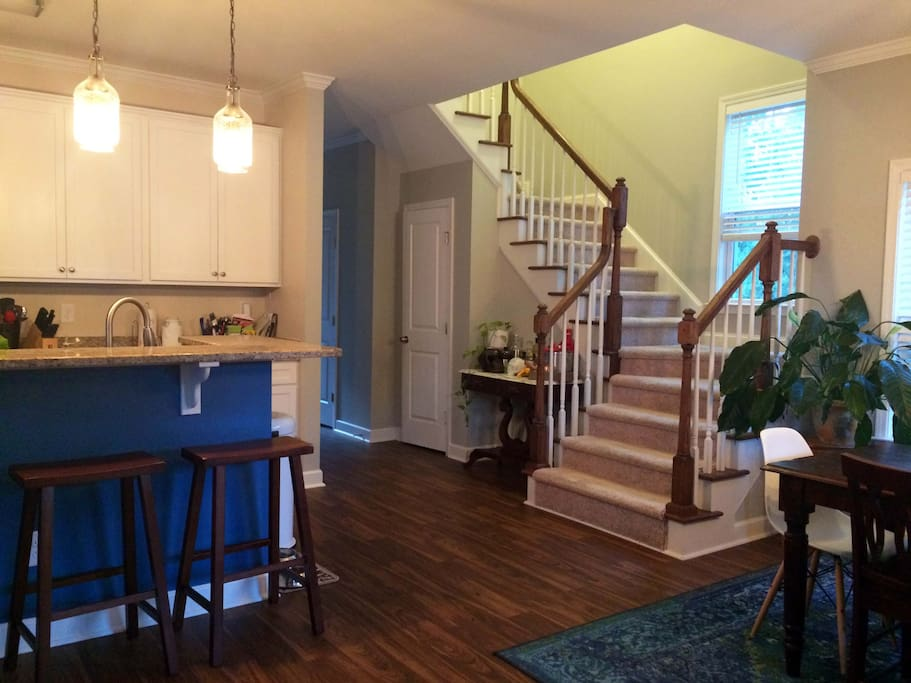 Shared space, kitchen and dining area. Guest rooms are right up the stairs.