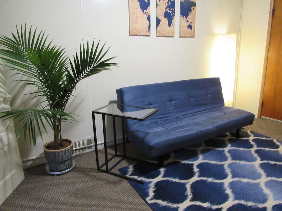 I love plants as you can see! Relax on our living room sofa while watching local channels on YouTube TV. At night, get your rest and recline the sofa into a bed.