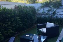 The outside area comes equipped with outdoor furniture perfect for lounging or enjoying drinks outside with friends.