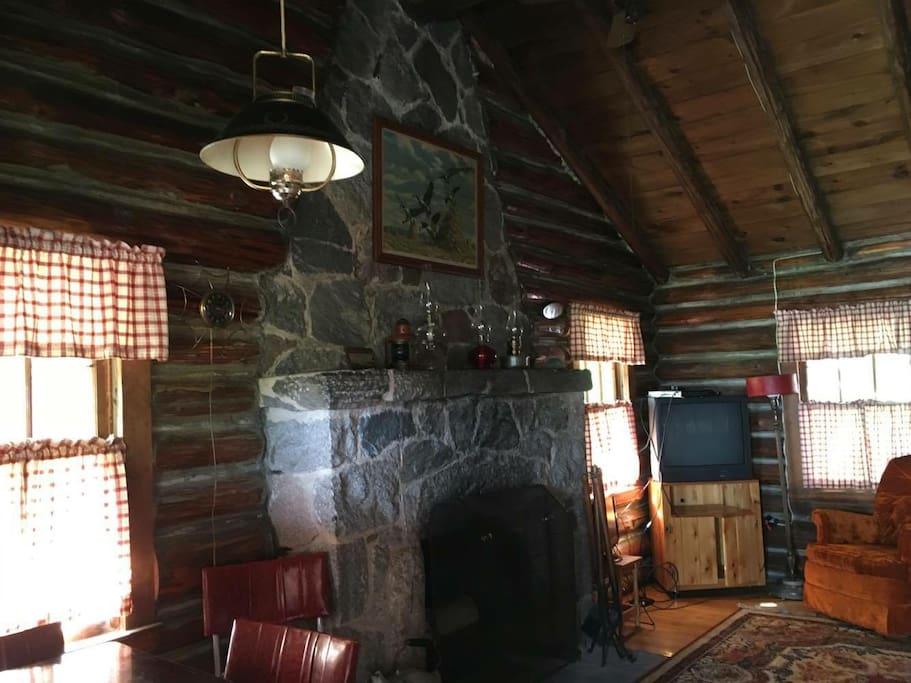 Beautiful log cabin with stone fireplace