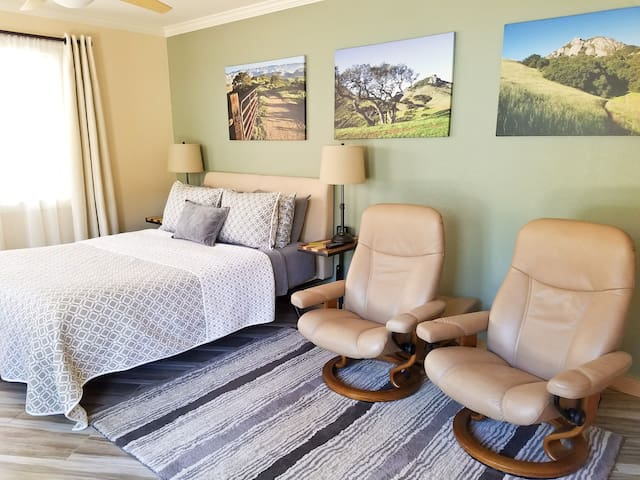 Throw rug in sitting area next to bed.
