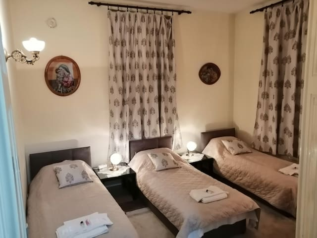 """3 single beds 200x90. 14 sq. meters room. 40"""" tv, heating, small table with 2 chairs"""