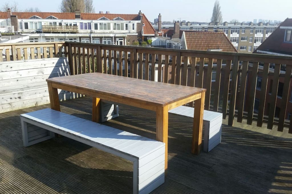 Table on roof terrace where you can sit and relax in the sun