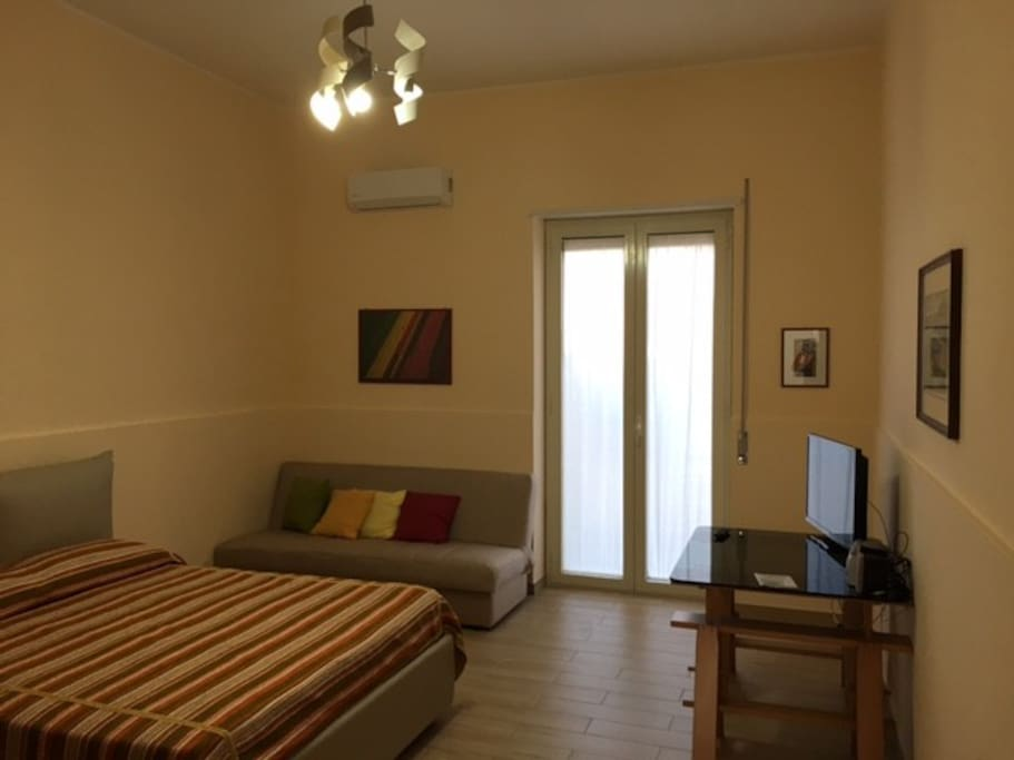 Master Bedroom (1 double bed, 1 sofa bed, Air Con, Wardrobe, TV, access to small terrace)