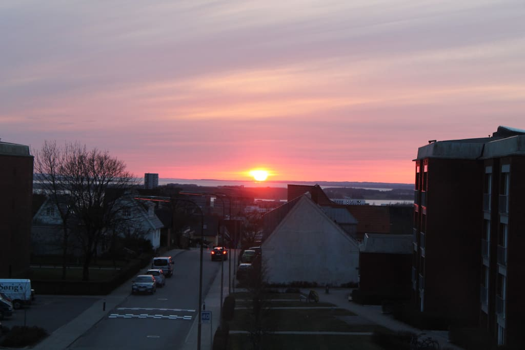 view to the west over the fjord, and some days with beautiful sunsets