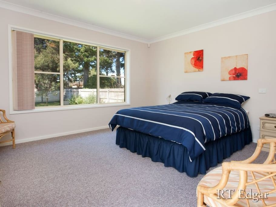 Comfortable bedroom with big window, lots of natural light