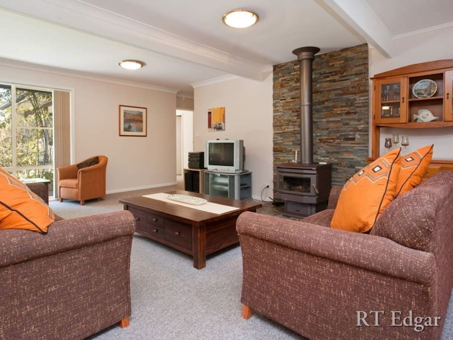 Tastefully furnished, comfortable living room with Coonara heating