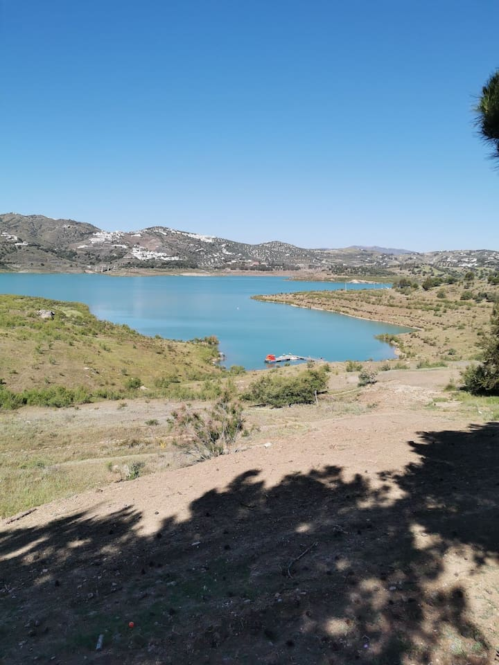 Lake Vinuela fed by the River Guaro.  A romantic spot for walking, mountain biking, birdwatching, sailing and kayaking. The area is known to produce the best olive oil in the world. A legacy of the moorish era. 30 mins from the beach Torre del Mar!