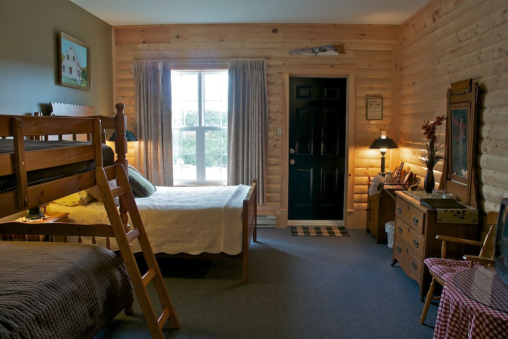 Bunk Beds and a double bed make this a great room for a small family.  Small Fridge, 2 burner stove, private bathroom