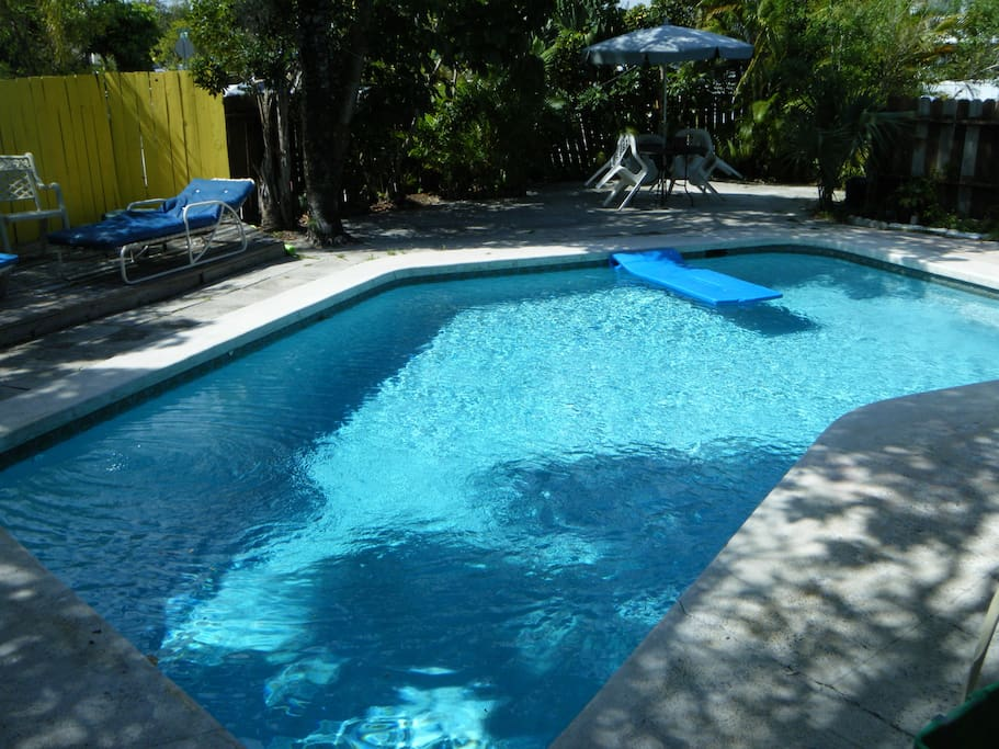 walk thru the back patio to this secluded pool shared with the house next door