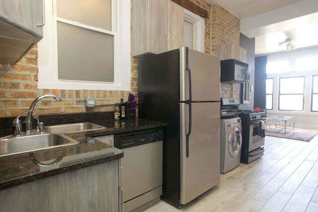 Fully equipped kitchen with oven, microwave, toaster, coffee machine and much more.