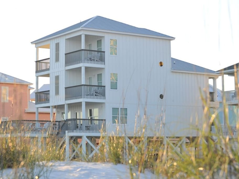South-side of home. There are 4 private balconies off the master bedrooms which over amazing unobstructed gulf views.