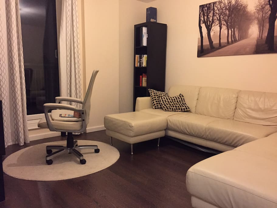Spacious lounge with TV and large wrap around sofa. Access to Balcony