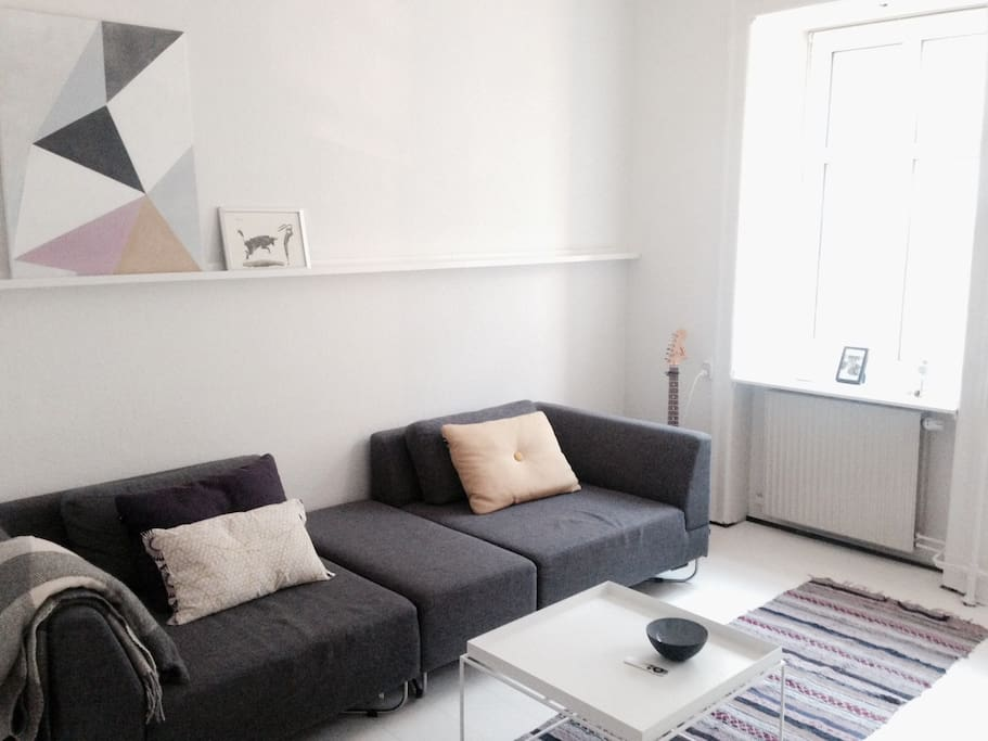 The cosy living room with a big sofa to relax on after a long day of sightseeing:)
