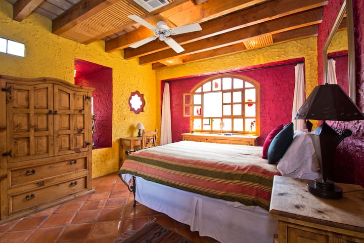 Relax and unwind in your queen-sized pillow-top bed and listen to the sound of the ocean waves in the bedroom of the Mexican Suite.