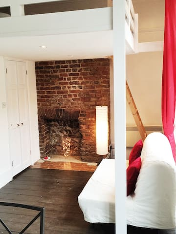 Comfy area, with ladder leading to mezzanine sleeping area.