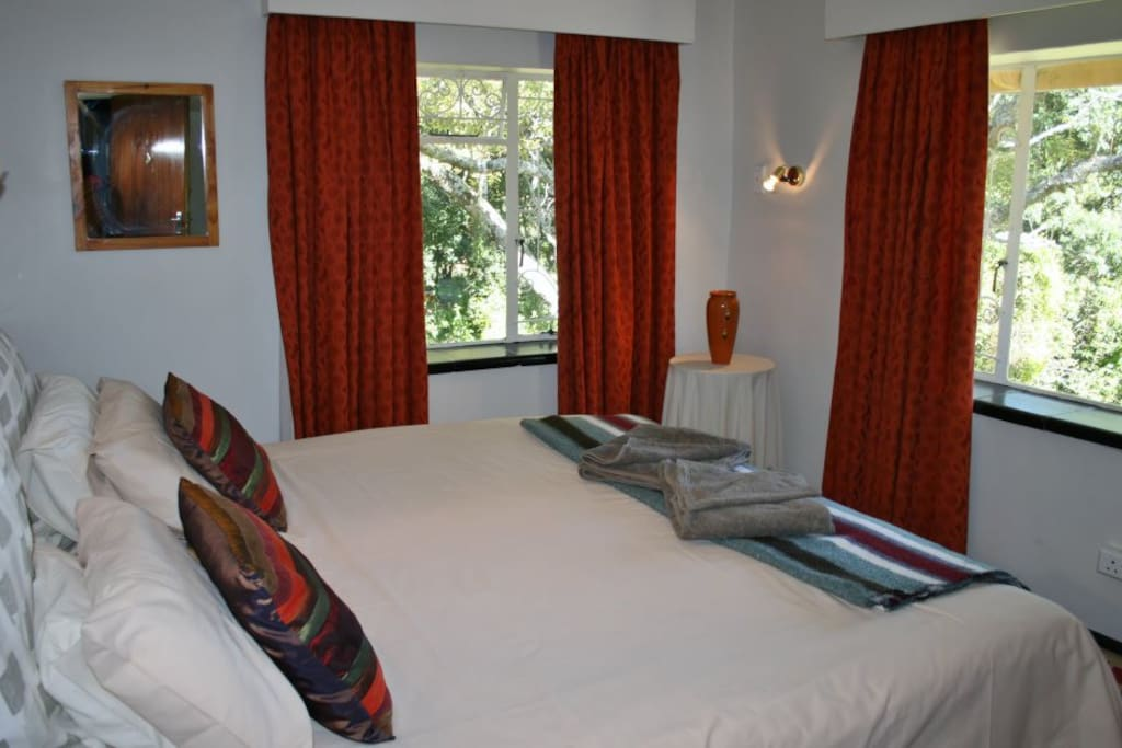 The second bedroom, with views onto our gardens and the mountains.