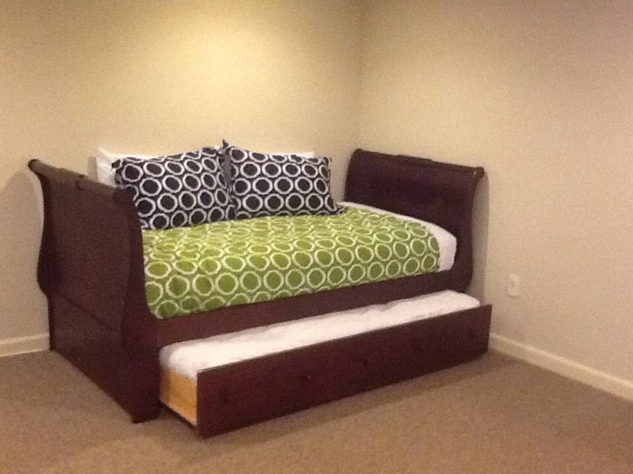 Trundle bed. The lower mattress is shorter than a normal twin mattress.