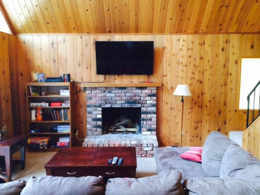 Living Room with Hearth Fireplace and Smart TV