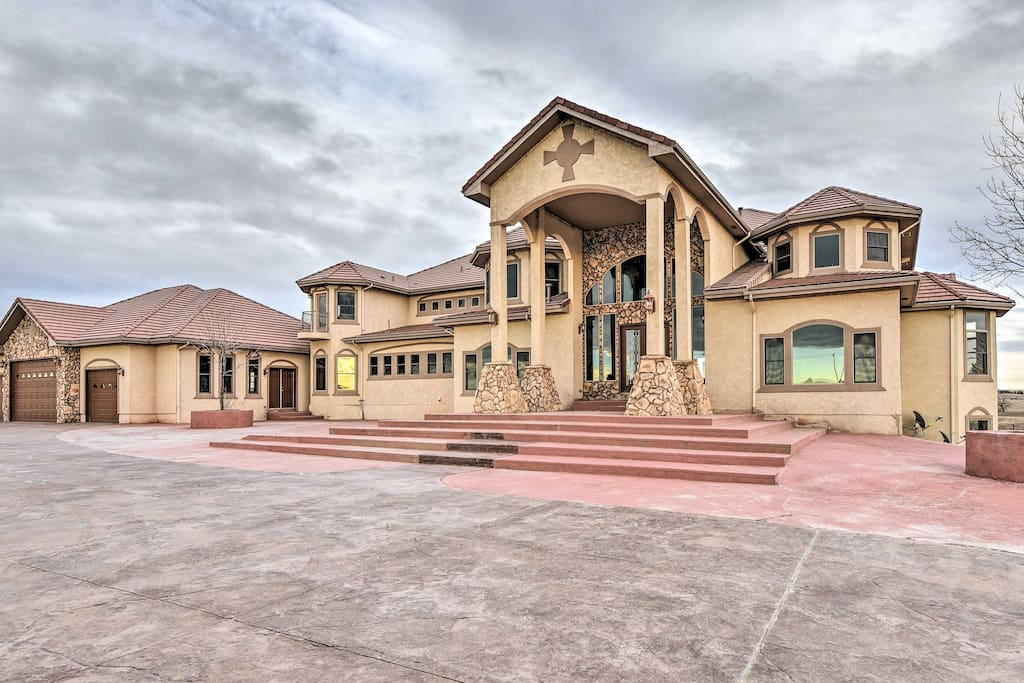 This home boasts 8,900 square feet and accommodates 12 to 14 guests!