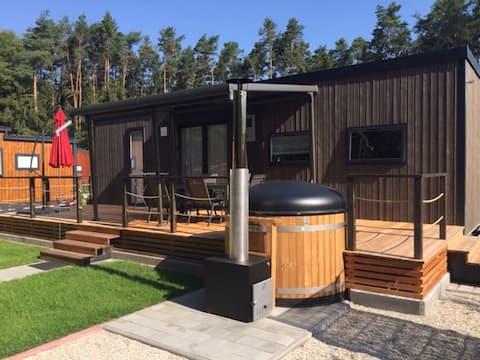 Mini casa en el lago Murner con accesorios de baño