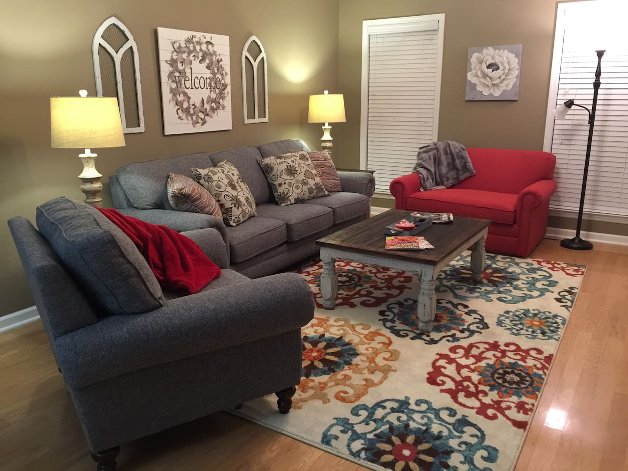 Den with sleeper twin bed in red chair