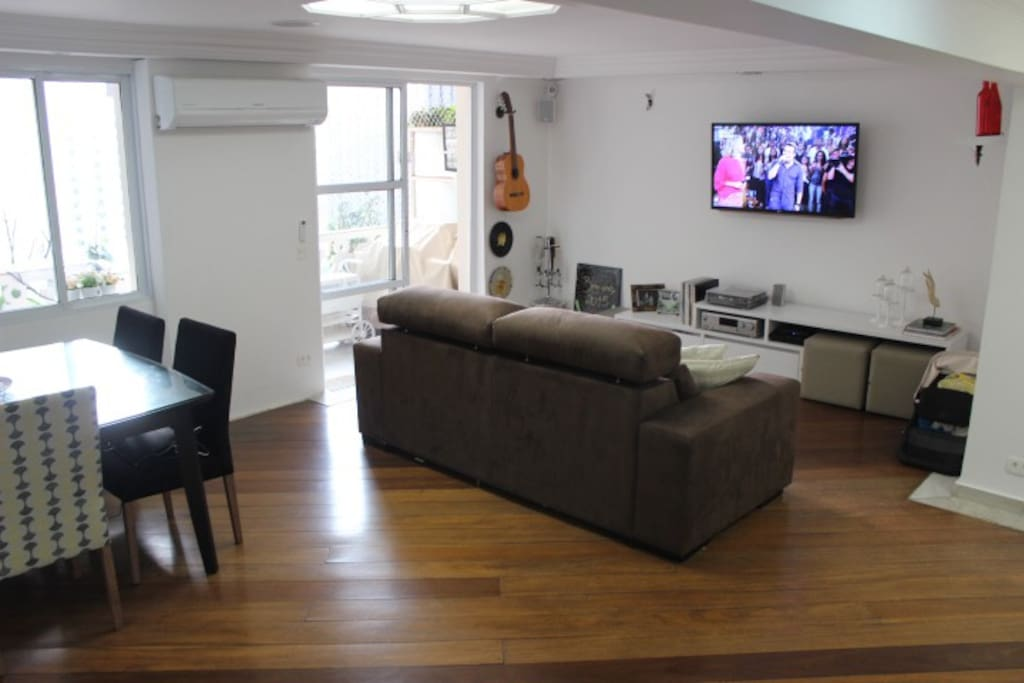 Spacious living room with cable TV, home theater and split air conditioner
