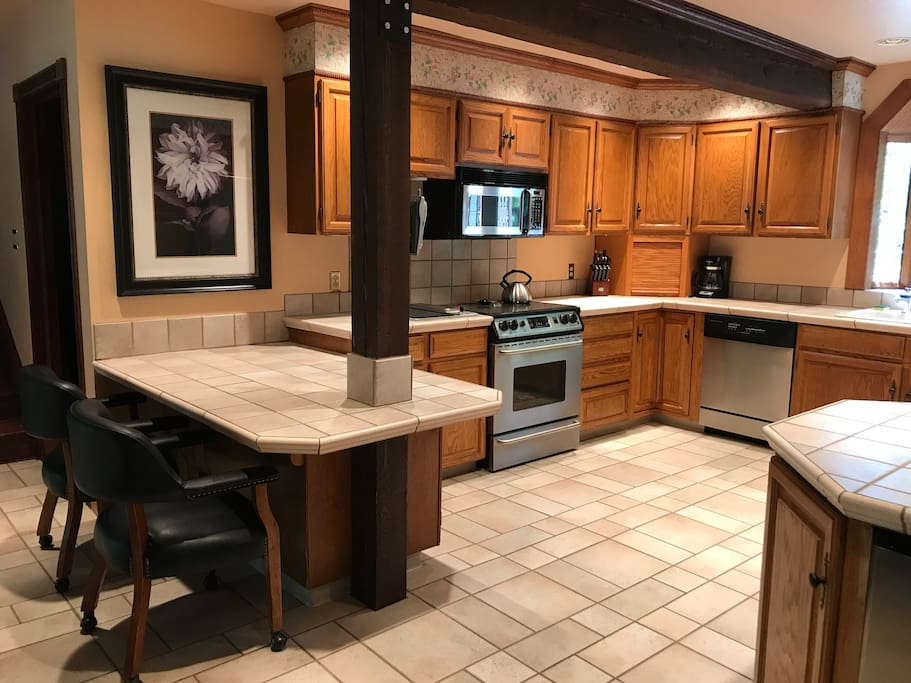 Large open Kitchen with utensils