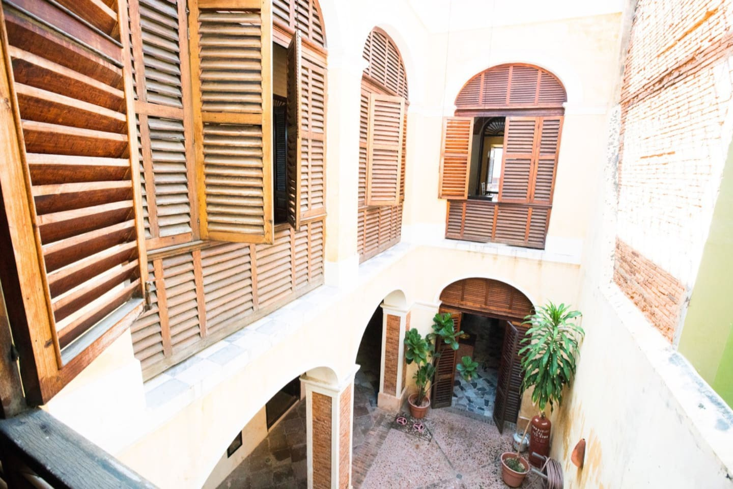 Take a peak into the downstairs interior courtyard as you listen to the peaceful sound of the fountain. Underneath hides a 36,000 gallon underground water cistern that supplies the house with its own water source.