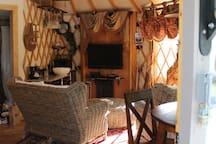 Flatscreen television, satellite DirecTV access and Internet are provided in the Yurt.