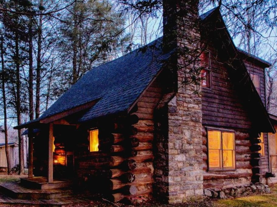 Cabin: This is the cabin in late fall at dusk. From this view, you can see the living room windows on the bottom floor, two bedroom windows on the top floor and the screened porch at the rear.