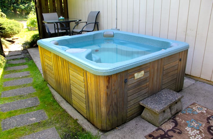 The beautifully-mainained hot tub just steps from your bedroom on your private patio