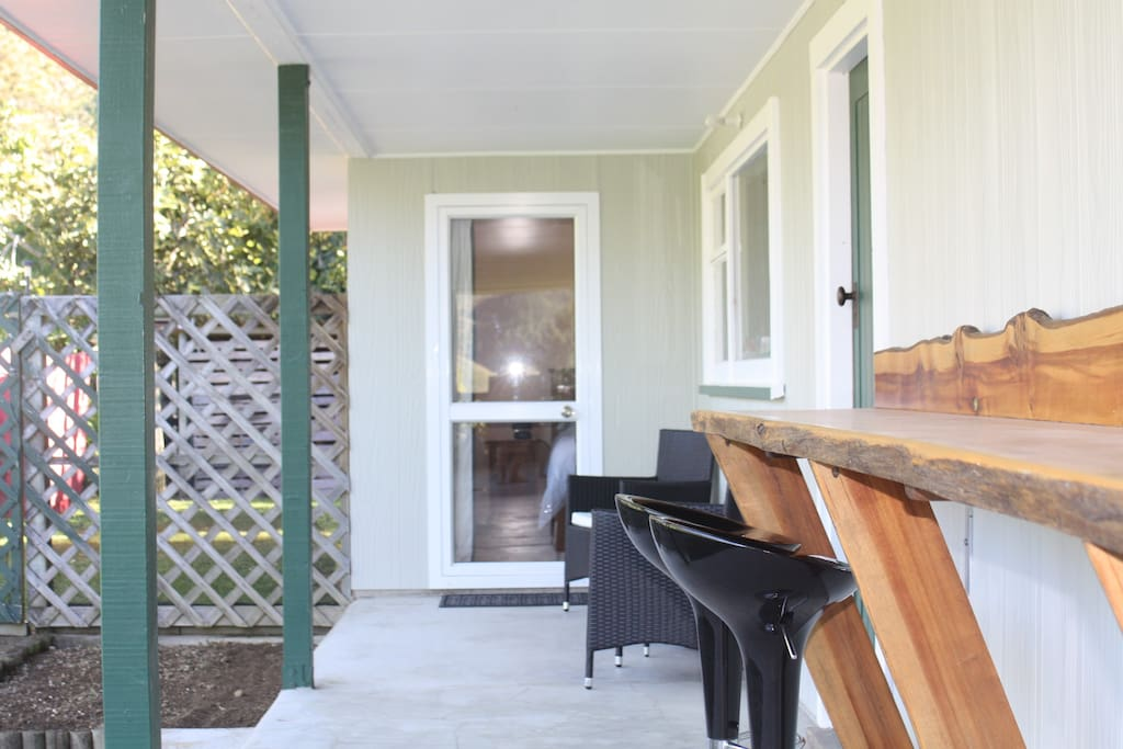 Your Private Entrance with Outdoor Seating and Coffee Table also Bar Stools and Bench