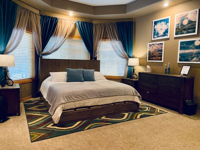 Large master bedroom with king size, memory foam bed
